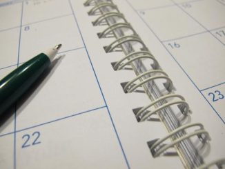 Photo of spiral bound calendar with pen