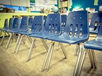 Empty rows of chairs in a classroom